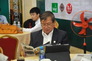 H.E Khieu Kanharith, minister of Information, honorary president of KDNK Founation, reads Kerdomnel Khmer Magazine.